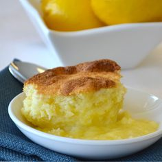 Yum!!  Lemon pudding cake bakes in water bath and separates into fluffy cake top with beautiful lemony sauce.