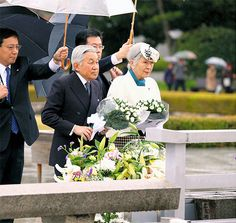 Emperor Akihito and Empress Michiko offer chrysanthemums at the cenotaph for atomic bombing victims in Hiroshima on Dec. 4. (Yoshihisa Aoyama)