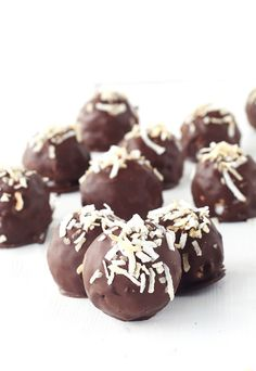 Hi friends! I have another quick and easy recipe for you today - only five  ingredients needed! These no bake Chocolate Coconut Truffles are  dee-licious. Little truffles of sweetened coconut covered in dark chocolate  and topped with toasted coconut.  The best part? They are so easy to throw t