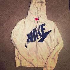 Nike size medium hoodie Super cute retro Nike hoodie. I never wear it...so it must go! White with navy logo. Perfect condition, worn/washed once. Nike Tops Sweatshirts & Hoodies