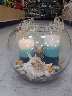 Seaside shell with coral in a giant fish bowl arrangement