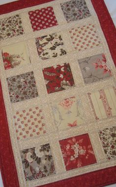 Wall Hanging quilted in red and ivory print by WarmandCozyQuilts