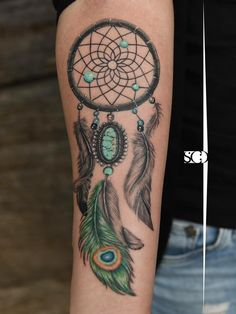 Dreamcatcher Tattoo by Catalin Limited Availability @ Revelation Tattoo Studios Northampton. Dreamcatcher Tattoo Arm, Peacock Feather Tattoo, Body Art Tattoos, Small Tattoos, Sleeve Tattoos, Thigh Tattoos, Girl Tattoos, Tattoo Studio, Native American Feather Tattoo
