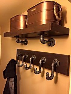 Dark walnut shelf and coat rack with industrial pipe hardware.