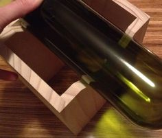 I wanted to recycle some old wine bottles into glasses and chandeliers. I have seen a lot of online tips about how to buy a jig to make the cut, sand the glass with a dremel, etc. But why buy a $20-30 jig that you can make yourself? Here are directions for an easy, solid jig using a cheap stained glass cutter and a few other supplies from your local hardware store.