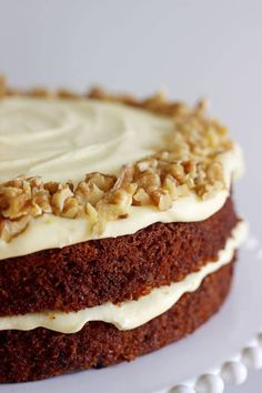 My all time favourite Carrot Cake recipe - loaded with grated carrot, crushed pineapple, crunchy walnuts and smothered in cream cheese frosting, this will become your favourite carrot cake recipe too! Carrot Cake Decoration, Mouth Watering Food, Crushed Pineapple, Cinnamon Cream Cheeses, Round Cakes, Cake Tins, Cream Cheese Frosting, No Bake Cake, Tea Time