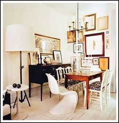 Mix & Match your chairs for a fun, funky look! Check out the eclectic wall art that creates the perfect backdrop for any occasion!