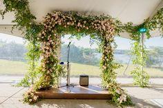 Another gorgeous altar. Garden style design, wooden platform beneath. Photo Credit: The Kenneys