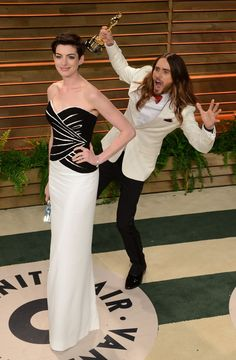 Pin for Later: The Year's Best Award Show Snaps  The fun photobombs continued after the Oscars, when Jared Leto snuck up behind Anne Hathaway on his way into the Vanity Fair bash.