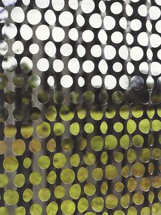 Corrugated and perforated metal as a shutter - from Dwell Magazine