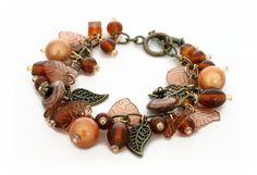 Leaf Themed Charm Bracelet bespoke handmade jewellery  by Lottieoflondon £20.00 #bespoke #jewellery '#bracelets #charmbracelets #autumnjewellery #giftideas