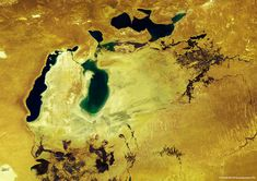 The Aral Sea was once a large endorheic lake between Kazachstan in the North and Uzbekistan in the South. It used to be one of the four largest lakes in the world having an area of km². Water Scarcity, World Water Day, Online Images, Aerial View, Solar System, Geology, Cool Things To Make, Astronomy, Asia
