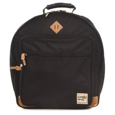 """From Tama:The Powerpad Designer Snare Drum Bag is designed to store snare drums up to 6.5""""x14"""". When transporting, the 20mm thick semi-hard cushion bring outstanding levels of protection from damage. Its tuck away backpack straps and ergonomic handle offers great portability. The front pocket has enough space for a laptop, sheet music or essential gig accessories. Last but not least, it comes in four color options tastefully accented with suede material. 6.5""""x14"""" Snare Drum Convertible Backpack Music Backpack, Snare Drum, Convertible Backpack, Backpack Straps, Suede Material, Herschel Heritage Backpack, Drums, Sheet Music, Cushion"""