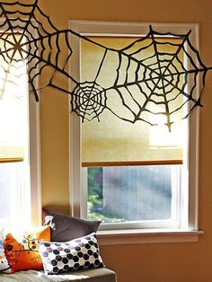Easy to make #DIY Trash Bag #Spider Webs for #Halloween via @HGTV
