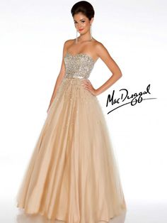 Gorgeous prom dress, with a classic bow at the waist!  We have this in the nude and the aqua!  Gigi's Closette