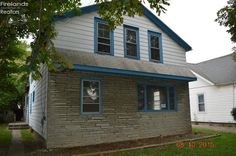 $11,400 Up/down duplex with a 2 car garage. Lower level is a 3 bedroom 1 bathroom with large kitchen, dining area, pantry, and basement access. Upper unit has 1, possibly 2 bedrooms with a living room, laundry in kitchen and extra storage across from unit. Property is being sold AS-IS.