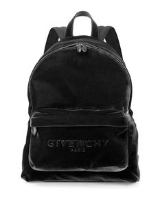 Givenchy velvet backpack. Looped top handle. Two-way zip-around top. Adjustable shoulder straps. Embossed large logo at front. Exterior zip pocket. Viscose. Imported.