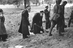 "Siege of Warsaw by German forces in September of 1939: Under the supervision of Polish soldiers, elderly religious Jews in Ortodox Russian chalats dig anti-tank trenches to impede the German invasion.  Date 	September 1939.ulien Bryan (23 October 1939). ""Documentary Record of the Last Days of Once Proud Warsaw"". Life magazine: 73-77."