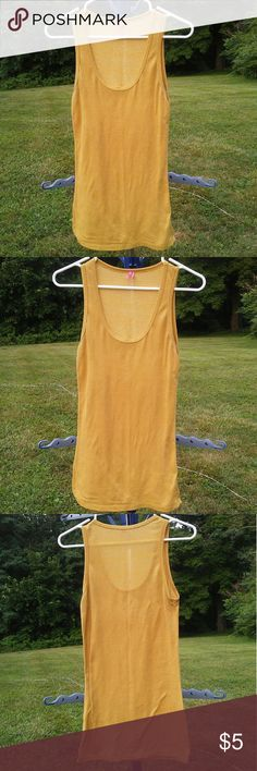 Gold Shimmer Stretchy Tank Top Gold Shimmer Stretchy Tank Top -57% Polyester/ 38% Lurex/ 5% Spandex  -gently used lola Tops Tank Tops