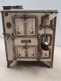 Old cooker enameled cast iron brand godin.  Year 1900 in Poele A Wood Godin Ancien in Rennes