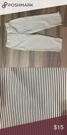 Ann Taylor pen stripped ankle pant Ann Taylor curvy fit ankle pant. Pants are ivory with black pen stripes. Size petite 6. Inseam is 21 1/2 inches. Material is 81% cotton, 16% nylon, and 3% spandex. Machine washable.  In excellent condition. Ann Taylor Pants Ankle & Cropped