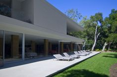 """""""This house is my opus. It's my greatest achievement of a career"""" – Steve Hermann Set within a acre estate of oak groves, the Glass Pavilion in Montecito, California envelops you in the natural beauty of its surroundings. Dream Home Design, House Design, Porches, Glass Pavilion, Luxury Modern Homes, Farnsworth House, California Homes, Montecito California, House Made"""