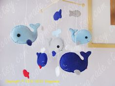 Baby Mobile - Whale Mobile - Fish Mobile - Hearts Raindrops theme - Serene Sea - Blue Gray Green Whale family (You can pick your colors). $92.00, via Etsy.