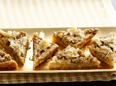 Baklava Bars~~~Yum!  Tastes just like the real thing.  The next time, I'll try it without the lemon zest and use the whole package of phyllo shells instead of just half.~~~~~Rose