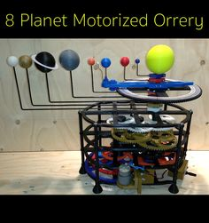 An Orrery is an apparatus used to illustrate the relative motion and sizes of planets to each other and their orbits around the sun.