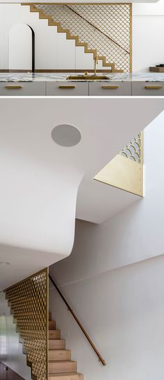 The stairs leading to the upper floors of this modern house have a brass finish balustrade with the fish scale pattern, providing an artistic feature that also meets the building code. The ceiling is also slightly artistic, in that it has been sculpted to negotiate the split level and allows for a light well over the living room.