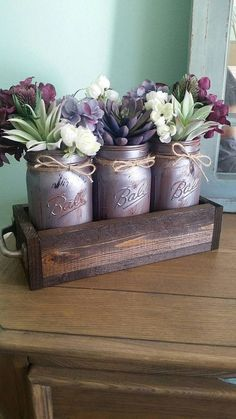 This centerpiece is the perfect blend with the beautiful succulents and fun metallic distressed jars! The floral design includes a mix of victorian purple, sage, and earthy cream. The handles are a new addition to my stock as well! The tray is 12 inches long and 5.5 inches wide. **Most popular color choices in the photos** ***If you would like to customize your piece then please include the following in your notes when you purchase: Colors you'd like for your jars, stain on the box, and any…