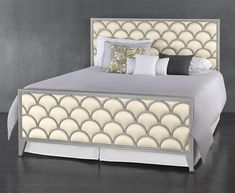 The Arnes upholstered iron bed is reminiscent to nature's delicate patterns of drifting clouds and aquatic scales.