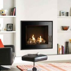 We offer a wide range of exceptional luxury fireplaces Glasgow including gas fires, electric fires and bespoke luxury fireplace design. Fireplace Tv Wall, Living Room With Fireplace, Fireplace Design, Wall Gas Fires, Stone Mantel, Contemporary Lounge, Traditional Fireplace, Family Room