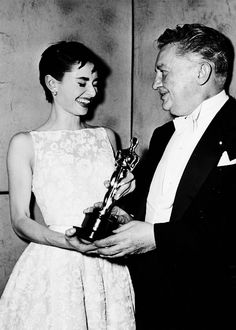 Audrey Hepburn with Jean Hersholt at the 26th Academy Awards, 1953.