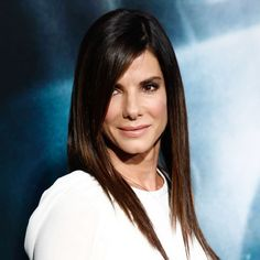 Fake Bangs  Add faux layers instantly with a deep side part. The hair over Sandra Bullock's eyes creates the illusion of long side-swept b...