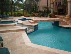 Tumbled travertine custom deck renovation - Tuscavilla, FL