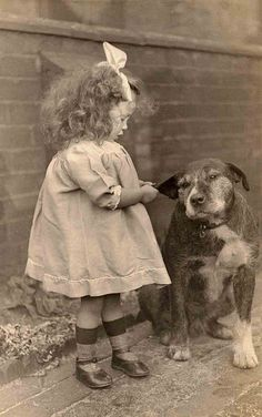 "girl and her dog…..I FOUND THIS SO CUTE…..LOOK AT HER CRAZY LITTLE SHOES, OVERSIZE DRESS, JUST-CURLED HAIR , LOPSIDED RIBBON AND HER FAVORITE DOG ""CRANBERRY""………….ccp"