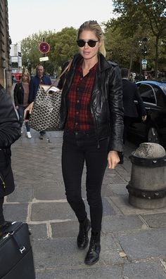 Doutzen Kroes in a flannel shirt, black skinny jeans, boots and a moto jacket.