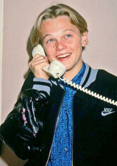 Young Leo talking on the telephone back in the day they all came with cords attached to them