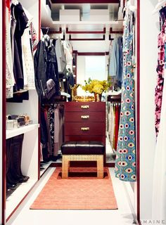 Clean and organized closet with step stool and rug.