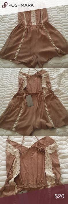 cutest romper!  Sexy and cute and comfy all in one!  ties in back with nice opening to show off back! Little v neck in front can be worn for a walk or any occasion. Love it! Mittoshop Pants Jumpsuits & Rompers