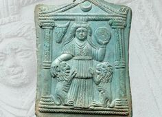 A Provincial Roman bronze votive top piece from a consecration, with name inscription, 2nd-3rd century A.D.