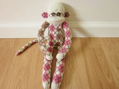 """Neapolitan sock monkey plush doll  pink cream by girliceclimber, $23.00  These are THE CUTEST Sock Monkeys I've Ever Seen!!  I recently purchased 1 of them I can assure you I'll be buying a few more. They are so soft and finely made; not to mention their """"mommy"""" is a delightfully nice lady named Megan and she'll take Great care of you and your future friends!!!  Please take a look at her many different designs and sized sock monkeys....They're absolutely Adorable and Nicely priced too!  I…"""
