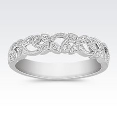 Hawaiian Wedding Ring This beautiful vintage inspired ring combines round diamonds with intricate milgrain detailing. Twenty-three round diamonds, at approximately carat total weight, are set in exquisite 14 karat white gold. The wedding band is wide. Vintage Diamond Wedding Bands, Stackable Wedding Bands, Wedding Rings Vintage, Wedding Ring Bands, Stackable Bands, Vintage Weddings, Pear Shaped Diamond Ring, Eternity Ring Diamond, Diamond Bands