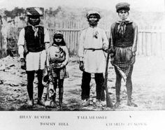 https://flic.kr/p/5PrhZU | Chief Tallahassee with son and other young men | Chief Tallahassee was never photographed without his rifle. Tommy is his young son.