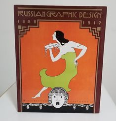 by Elena Chernevich. New York: Abbeville, 1990. First Edition. Abbeville. Compiled by Mikhail Anikst & Nina Baburina. Designed by Mikhail Anikst. Quarto. 160pp. Near Fine in Near Fine dust jacket. Black cloth decorated in gilt design. 355 illustrations, 294 in full color, capturing the commercial art and designs of Russia from 1880-1917.