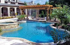 Free form swimming pool cascade waterfall and spa by Blue Haven Pools