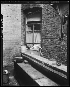 One of the rear windows, tenement dwelling of Mr. and Mrs. Jacob Solomon, 133 Aveue D, New York City. The Solomon family are on the accepted list for resettlement at Hightstown, New Jersey.  Dorothea Lange, June 1936.  Photogrammar