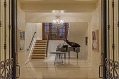 home entryway with piano