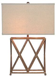 Modeled after an antique flea-market find in Paris, this airy table lamp features exquisite steel cagework full of depth and shine. A hardback off-white shade casts light from above.